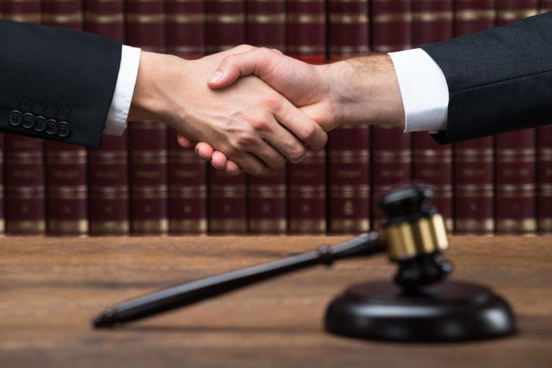 judge-shaking-hand